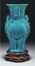 A turquoise glazed fluted vase
