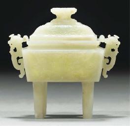 A pale celadon jade archaic-st