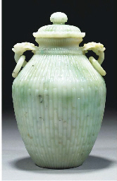 A pale green jadeite vase and