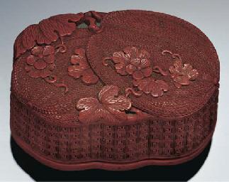 A cinnabar lacquer box and cov