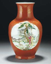 A coral ground baluster vase,