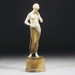 A patinated bronze and alabast