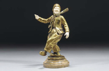 A gilt bronze and ivory figure