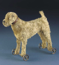A Steiff Irish Terrier on whee