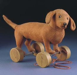 A Steiff Dachshund on wheels