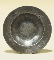 A RARE ENGLISH PEWTER SAUCER OR SPICE PLATE