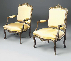 A pair of painted armchairs
