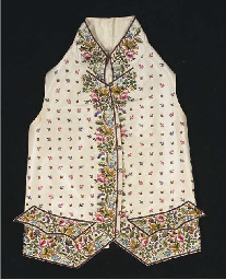 A gentleman's waistcoat of ivory silk, the high collar, front opening and...