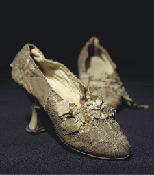 A pair of lady's shoes , the snuff ground brocade woven with flowers and...