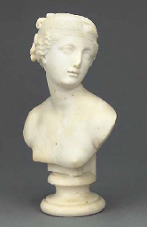 A carved marble bust of a lady