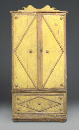 A PINE YELLOW PAINTED CUPBOARD