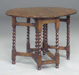 AN ENGLISH OAK GATELEG TABLE