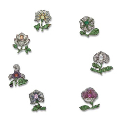 A MAGNIFICENT SET OF SEVEN DIAMOND AND GEM-SET MOGHUL FLOWER BROOCHES, BY JAR