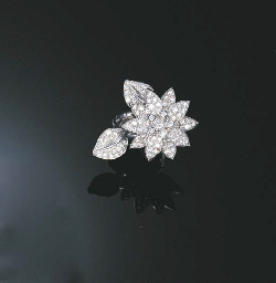 A DIAMOND LOTUS RING, BY VAN CLEEF & ARPELS