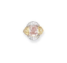 AN IMPORTANT FANCY INTENSE ORANGY PINK DIAMOND AND YELLOW DIAMOND RING, BY...
