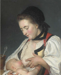 A Mother feeding her child