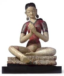 A Polychromed Wood Figure of T