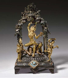 A GILT BRONZE FIGURAL GROUP OF