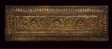 A CARVED GILT AND PAINTED MANU