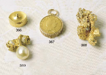 A MINIATURE GOLD NAVETTE SHAPE
