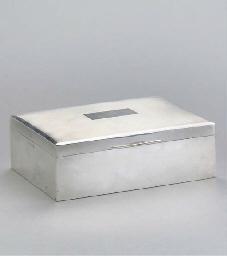 A MODERN SILVER CIGARETTE BOX