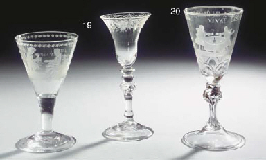 A Dutch engraved 'trade' drawn-trumpet goblet and a Dutch light-baluster goblet