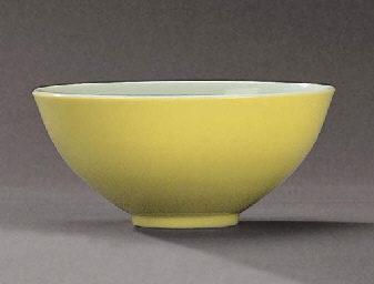 A LEMON-YELLOW ENAMELLED CUP