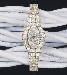 A LADY'S DIAMOND AND 18K GOLD