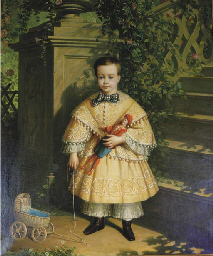 A child in a yellow tunic hold