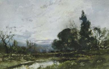 Cattle watering in a landscape
