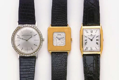 A GROUP OF THREE GOLD WRISTWAT