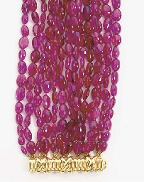 A PINK TOURMALINE AND 18K GOLD