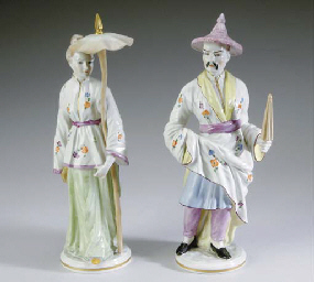 A PAIR OF FAIENCE FIGURES,