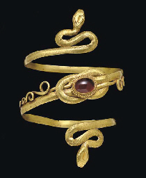 A GREEK GOLD AND GARNET SNAKE ARMBAND