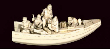 A Japanese ivory model of figures in a boat, late 19th Century