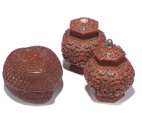 A CHINESE CARVED CINNABAR LACQUER PEACH-SHAPED BOX AND COVER; AND A PAIR OF...