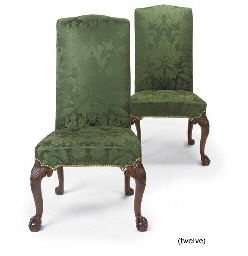 A SET OF TWELVE WALNUT DINING-CHAIRS