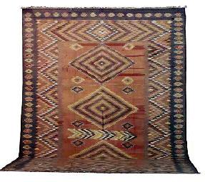 AN INDIAN DHURRIE CARPET,