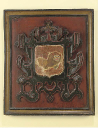 AN ENGLISH CARVED OAK ARMORIAL