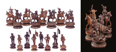 A GERMAN CARVED BOXWOOD AND CEDAR FIGURAL CHESS SET