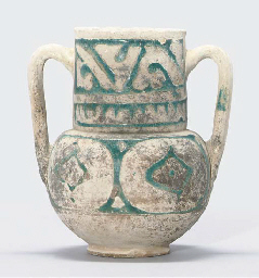 AN ALMOHAD POTTERY TWO-HANDLED