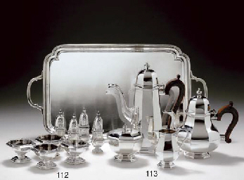 AN ELIZABETH II SILVER FOUR-PIECE TEA AND COFFEE SERVICE WIT...