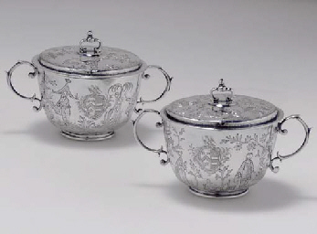 A PAIR OF JAMES II SILVER TWO-HANDLED CUPS AND COVERS FROM T...