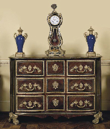 A REGENCE ORMOLU MOUNTED AND BRASS-INLAID AMARANTH AND STAIN...