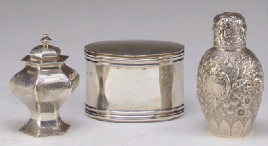 A TIFFANY SILVER TEA CADDY AND AN EDWARDIAN SILVER OVAL BOX ...