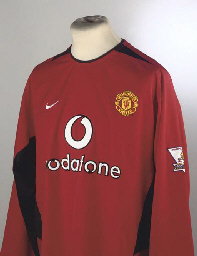 A RED MANCHESTER UNITED SHIRT