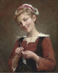 A young girl knitting