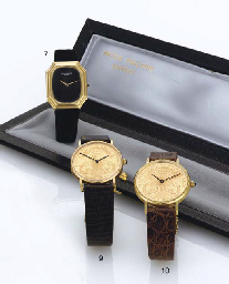 BAUME & MERCIER.  AN 18K GOLD