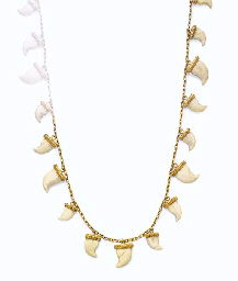 **AN IVORY AND GOLD NECKLACE,