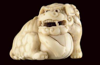 A Japanese ivory netsuke of a